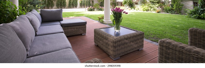 Comfortable gray couch in the luxury garden