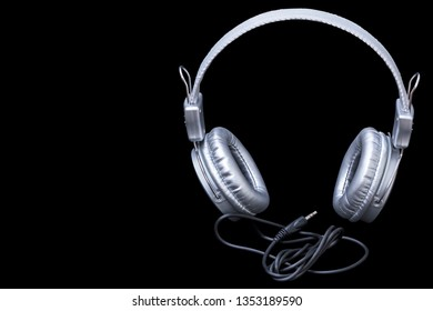 Comfortable high-quality headphones silver. Copy space.