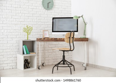 Comfortable home workplace with computer on desk