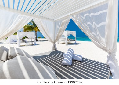 Comfortable lounge canopy on VIP beach seascape. Design of tourism for summer vacation holiday destination concept.