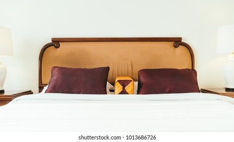 Comfortable pillow on bed decoration interior of hotel room