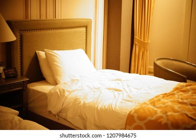 Comfortable pillow on bed decoration in hotel bedroom interior