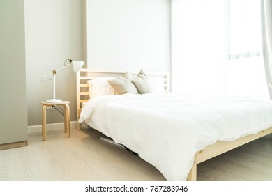 Comfortable Pillow on bed decoration in bedroom interior