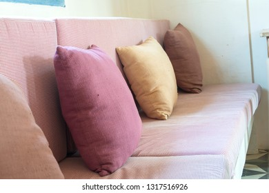 Comfortable pillow on sofa bed of pink color