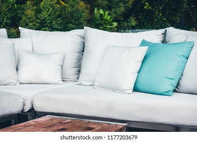 Comfortable pillow on sofa decoration outdoor patio with tropical and nature view
