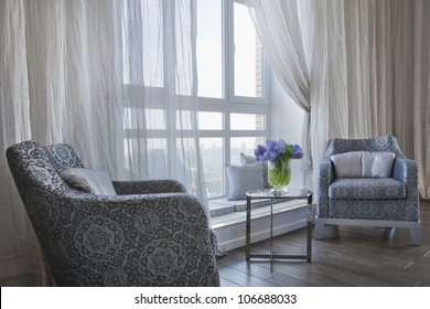comfortable room corner, two chair and tea table by the window