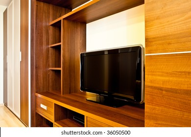Comfortable room with TV and wardrobes