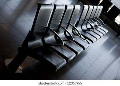 Comfortable row of black seats in an airport lobby