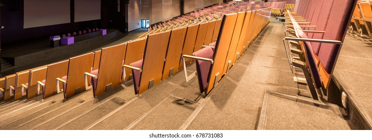 Comfortable seats in spacious modern lecture hall at new university building