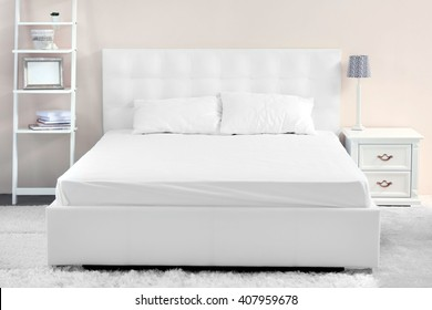 Comfortable white bed in the room