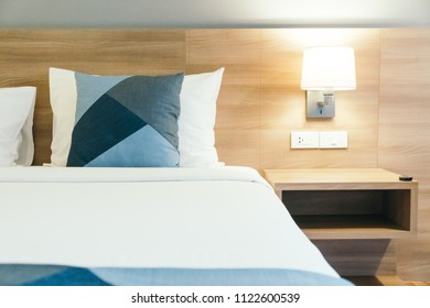 Comfortable white pillow on bed decoration in hotel bedroom interior