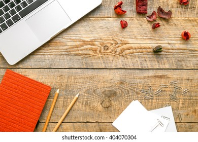 Comfortable working place with laptop at wooden table
