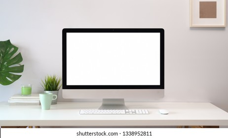 Comfortable workplace with blank screen computer.