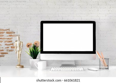 Comfortable workplace with modern desktop computer. Blank screen for graphic display montage.