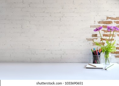 Comfortable workspace desk with house plant, pencils and copy space
