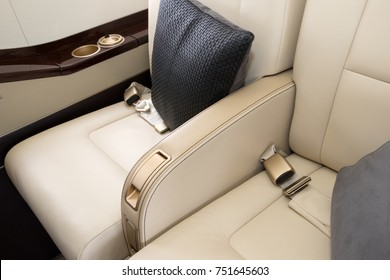 Comfortible chairs in a modern business jet airplane.