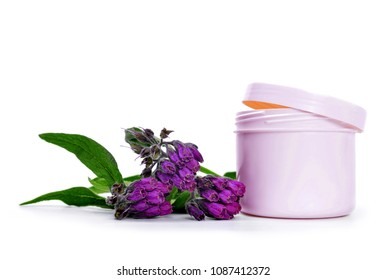 Comfrey cream with fresh Symphytum Officinale plant isolated on white background.