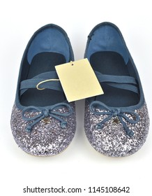 Comfy shimmer silver blue ballerina flat shoes with crossed elastic drawstrings and a price tag isolated on white