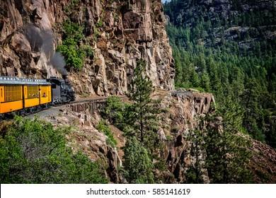 Coming Around the Mountain/The Durango Silverton Narrow Gauge Railroad takes passengers along sheer cliffs and around mountain bends.