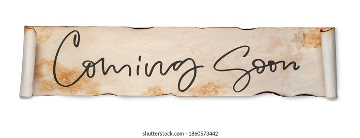 Coming soon. Handwritten inscription on a scroll of old paper. Isolated on white