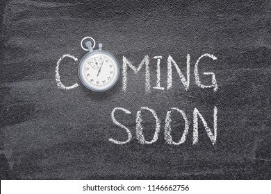 coming soon phrase written on chalkboard with vintage stopwatch used instead of O