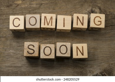 Coming Soon text on a wooden background