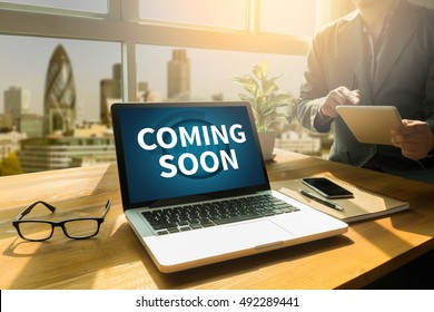 COMING SOON Thoughtful male person looking to the digital tablet screen, laptop screen,Silhouette and filter sun