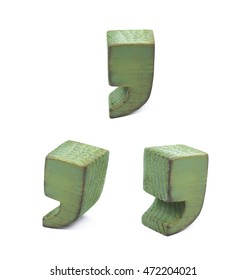 Comma symbol sawn of wood and paint coated, set of three different foreshortenings
