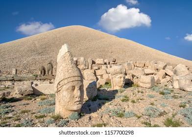 Commagene statue ruins on top of Nemrut Mountain in Adiyaman, Turkey. Stone heads at the top of 2150 meters high Mount Nemrut. Turkey