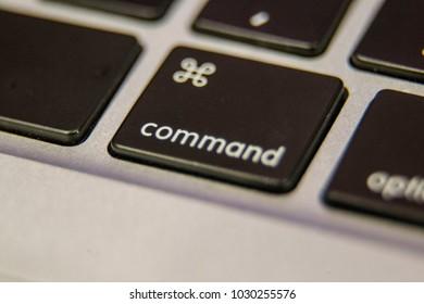 Command key symbol Keyboard key button press type close up macro desktop laptop computer black silver detail technology blog write