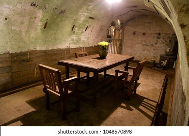 """A commander office in the Japan Navy Trench is used during the world war II when Pacific War outbreak in Ryukyu Islands, Okinawa, Japan. Translation of the word on the wall:"""" Destroy Ugly American"""""""
