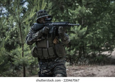 Commando aiming with assault rifle at enemy target