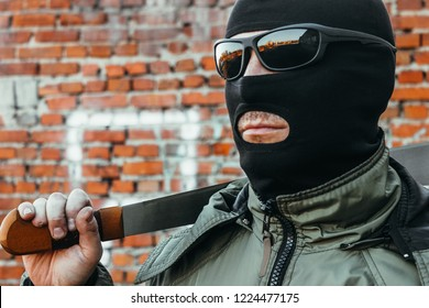 Commando in a mask with a machete