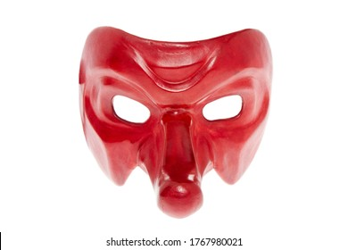 commedia dell'arte theater mask in red leather on white studio isolated background