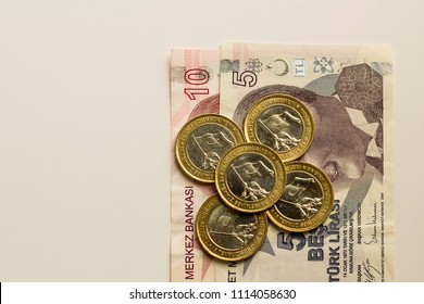 Commemorative money is about Fifteen July Of Turkey.Five commemorative coins (one lira)on fifteen banknote Turkish Lira,on the white surface,isolated.