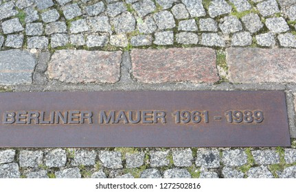 commemorative plaque placed on the site where once stood the Berlin Wall with text BERLINER WALL that means Wall of Berlin in German language and the years