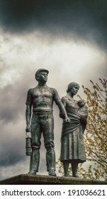 Commemorative vintage  statue of miner, wife and child.