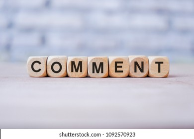 Comment word written on wood block