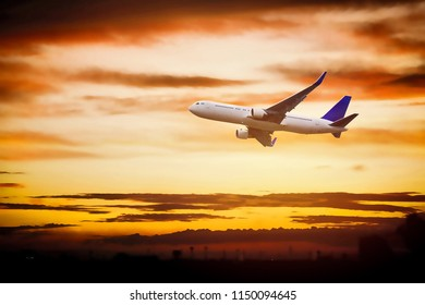 Commercial aircraft in the golden sky, dawn bright morning.