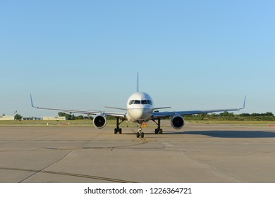 Commercial aircraft on the tarmac on a sunny day