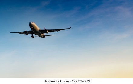 Commercial airline. Passenger plane landing at airport with beautiful blue sky and white clouds. Arrival flight. Welcome tourist from overseas. Vacation time. Happy trip. Airplane flying on bright sky