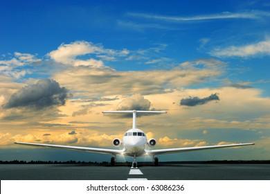 Commercial airliner on runway at dusk
