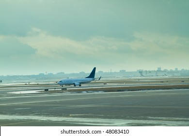 A commercial airplane coming in after making a landing.  Pearson International Airport, Toronto, Ontario, Canada