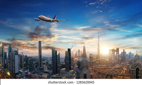 Commercial airplane flying above clouds and Dubai city, in beautiful sunset light. Modern and fastest mode of transportation, business life. Very high resolution image