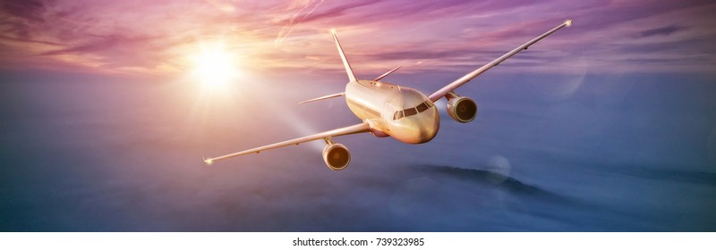 Commercial airplane flying above clouds in dramatic sunset light. High resolution of image. Fast Travel and transportation concept