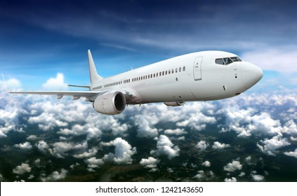 Commercial airplane flying above white clouds.