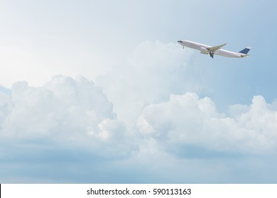 Commercial airplane flying over bright blue sky and white clouds. Elegant Design with copy space for travel concept.