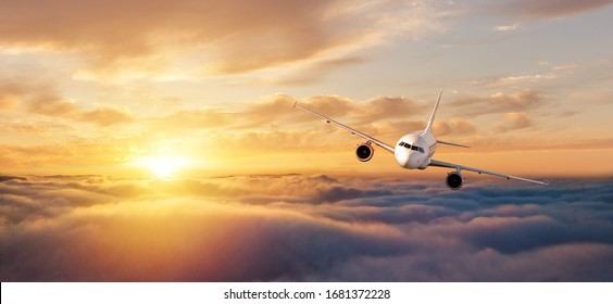 Commercial airplane flying over dramatic sunset sky. Jet plane is the fastest mode of modern transportation.