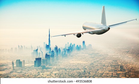 Commercial airplane flying over modern city with skyscrapers