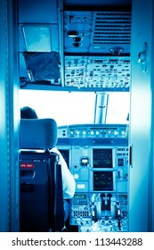 Commercial airplane interior cockpit color processed blue